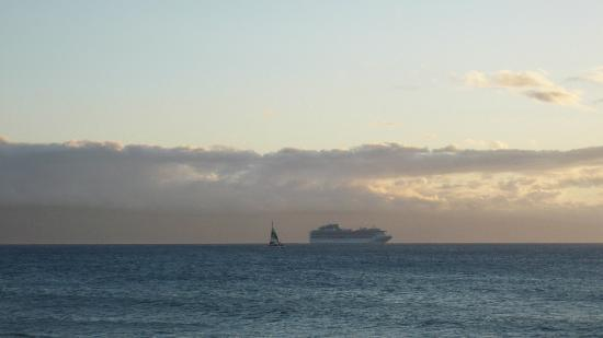 Kulakane: sailboat & cruiseship sailing into the sunset