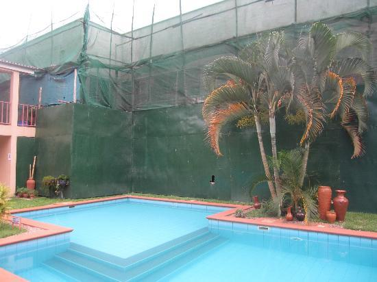Urban by CityBlue Kampala, Uganda: Across the pool to the renovation in progress
