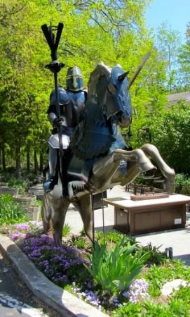 The English Inn : Two knights on their trusty steeds guard the entry.