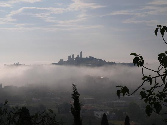 Poggetto di Montese: view to San Gim through the morning mist