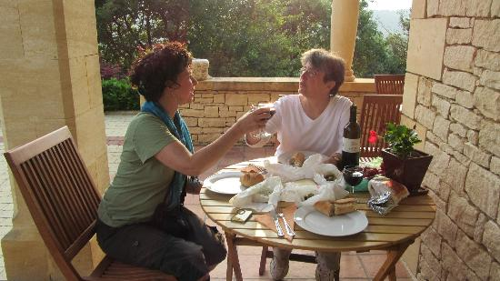 Hotel Bon Encontre : Enjoying dinner on the terrace with food bought at the farmer's market!