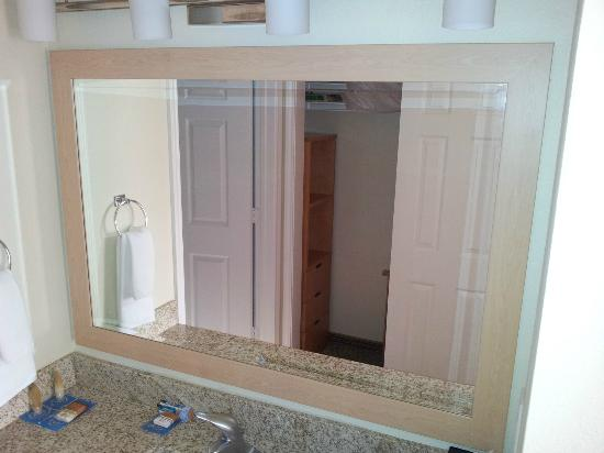 HYATT house Colorado Springs: From bath area looking into mirror to show closet