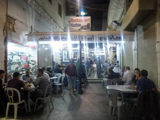 Street view of Hashem's restaurant at night