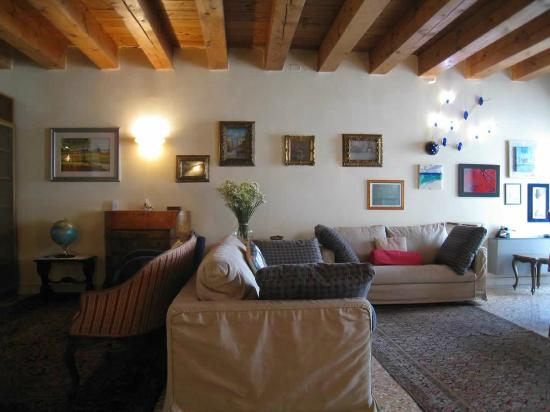 PadovaResidence: Living room of Ca Bimba. Dig the ceilings!  Isabella's artwork adorns the walls.