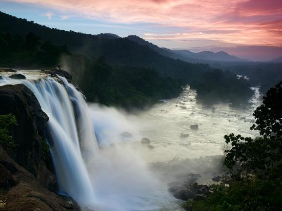 Thrissur, India: Sunrise at Athirapally waterfalls
