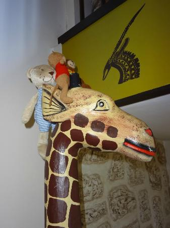 Suite 259: Peter 1, Peter 2 and Aziz on a giraffe