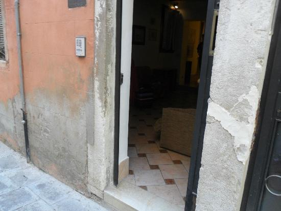 Residenze Sinfonia Veneziana: door into apartment which looks dismal