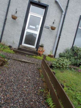 Phoenix House: view of front door with dead plants. quite unweldoming