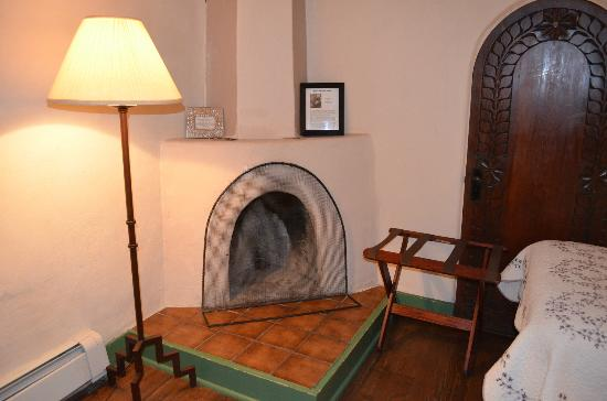Mabel Dodge Luhan House: Fireplace in the Willa Cather Room; firewood is available just outside the door.
