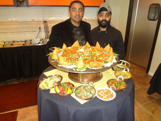 Kasturi Indian Cuisine: Bj Patel and Chef Isham Singh presenting the weekend lunch buffet