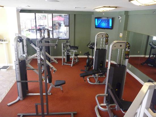Jockey Club: Workout area with hot tub, by the pool, open 24 hrs