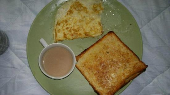 The Eee Cee Hotel: They have set breakfast tried alu paratha n bread omlette.....