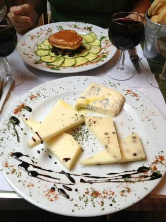 Le Baron Perché : baked smoked provolone atop mushrooms and zucchini