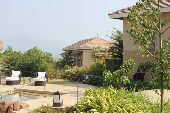 Swimming pool overlooking lake pavna picture of tungi - Hotel with private swimming pool in lonavala ...