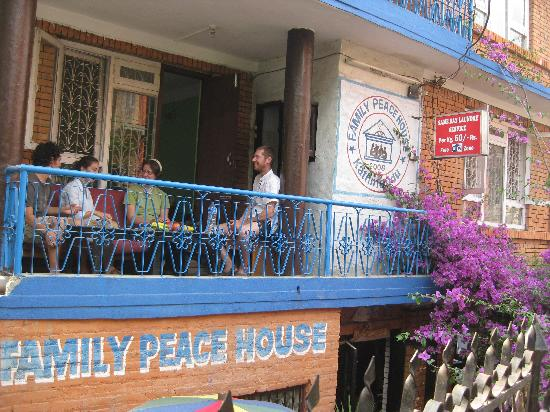 Family Peace House: guest sitting in balcony