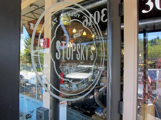 "Stopsky's Delicatessen: ""Eat, enjoy, return"" inscribed on the door and they mean it."