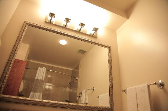 Asbury Inn & Suites: New mirror, lighting, and shower surrounds