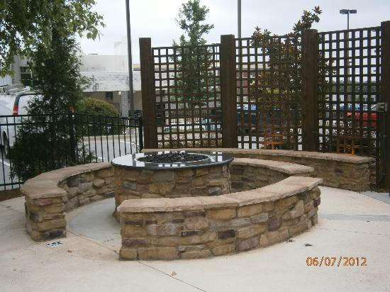 Gas fire pit and seating area near the pool. - Picture of ...