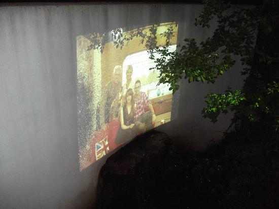 The Grimscote Manor Hotel: Outside projector (under bridge, projecting on to a wall with a small waterfall n pond underneat