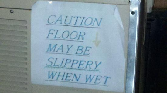 Olive Hotel: Slippery When Wet Sign