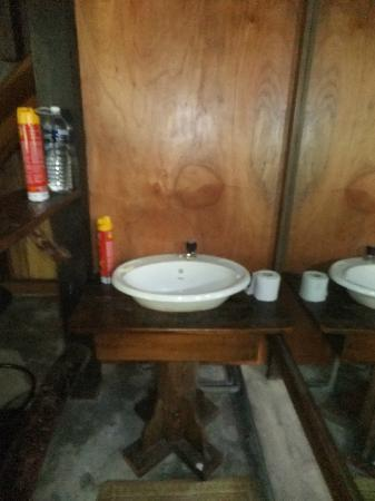 "Mirage Island Resort: Sink is outside the toilet. Double storey accomodation - ""Lau Teng 2"""