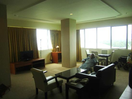 Muar Traders Hotel: living area, couch with lcd tv & dining table
