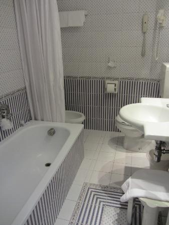 hotel plaza bathroom compact but clean and charming with country french decor - Compact Hotel Decor