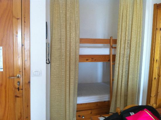 Residence Buganvillea: the little bunks that make up 2 of the beds, divided by curtains from the lounge/kitchen.