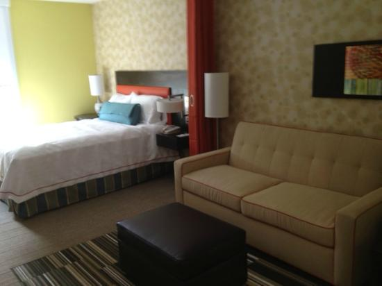 Home2 Suites Biloxi North / D'Iberville: queen bed with pull out sofa (orange curtain divides room)