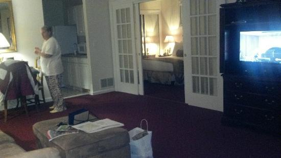Hotel Northampton: Double doors separate living area from bedroom kitchen and bathroom to the left