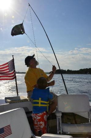 Solomon T Harbor Tours: Our 4 year old son assisting Captain Bert raising The Pirate Blackbeard's flag on our way back i