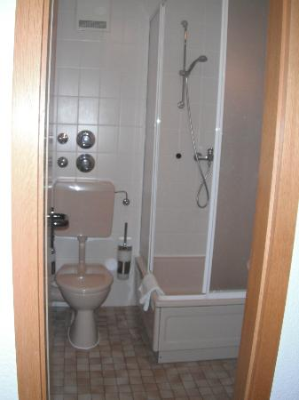 Hotel Tiffany: bath is divided into sink area and toilet / shower area by an internal door.