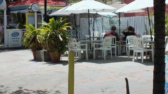 Cafe Livin : Several outdoor tables shaded by umbrellas