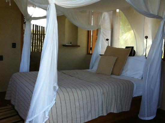 Playa Viva: Open concept bedroom and bathroom just steps away from the ocean