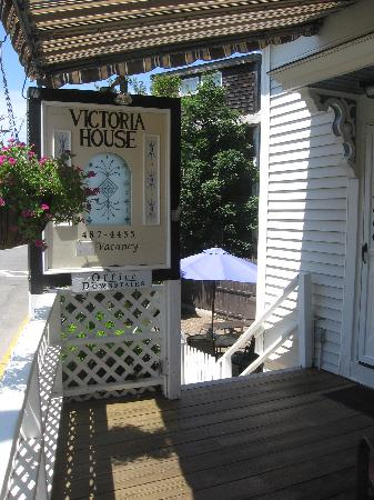 Victoria House: Front Porch Deck with Awning
