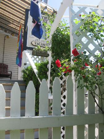 Victoria House: Trellis entry with roses