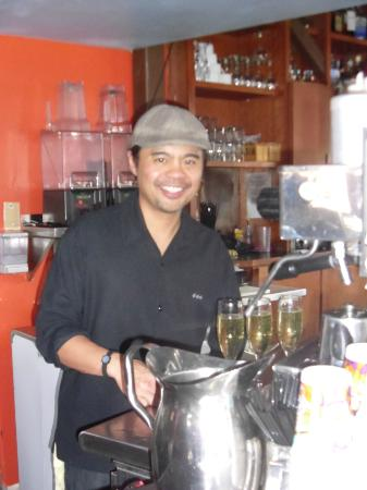 Cafe 163: Co-owner/manager Jeff Sandoval serving up guests on a busy Sunday morning.