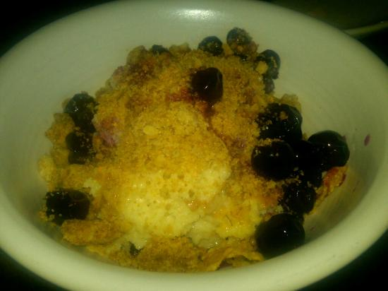 Girl & The Goat: Quad-leche cake with crumbles and blueberries