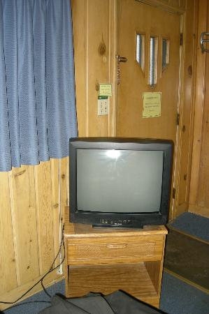 "Water's Edge Motel: The ~24"" tv... notice windows in door that allow morning light to wake you up"