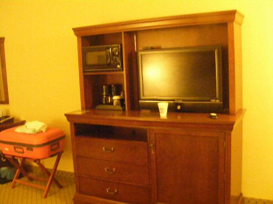 Inn at Pelican Bay: The TV, over the fridge, with coffee maker and microwave alongside.