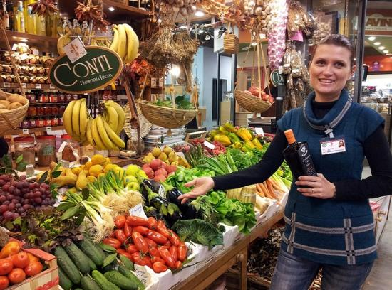 Bites of Florence Tours: Alina the Tour Leader is showing gooding at San Lorenzo covered market