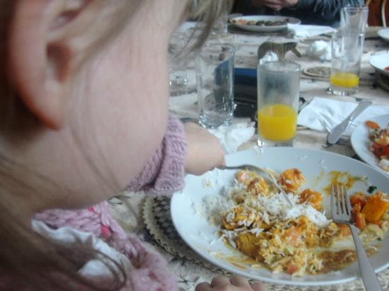 C & W's African Experience: This is my baby shovelling in her curry and rice!!