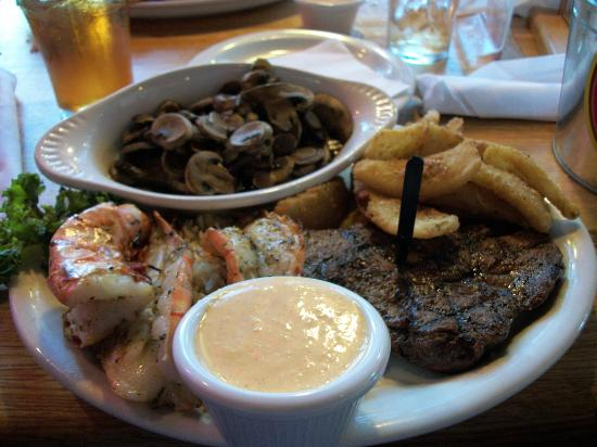Logan's Road House: Shrimp and steak with mushrooms and onion petals