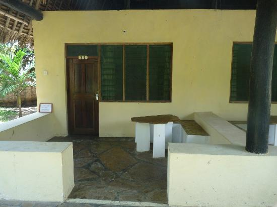 Makuti Villas Resort: Patio in front of unit....no comfortable seating. Only one chair in room.