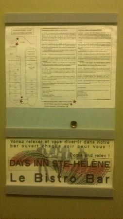 Days Inn - Ste. Helene-de-Bagot: Invitation to the bar below a happily starred escape map on the back of the door