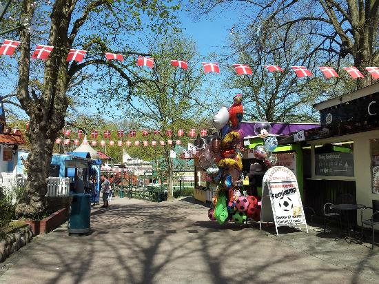 Bakken - World's Oldest Amusement Park: walkways thru the park festively decorated with Danish flags