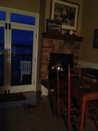 Cottage on the Cove: The fireplace at night