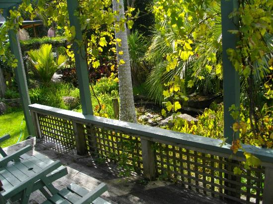 Milestone Cottages: View from deck to fish pond