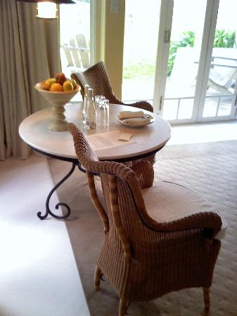 Wharekauhau Country Estate : Table opposite the bed