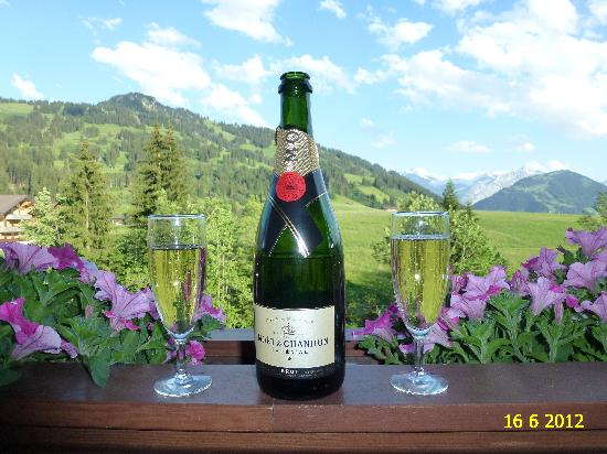 ERMITAGE Wellness- & Spa-Hotel : CHAMPAIN READY TO BE ENJOYED ON BALCONY OF OUR SENIOR SUITE TYPE SAANEN NUMBER 414.